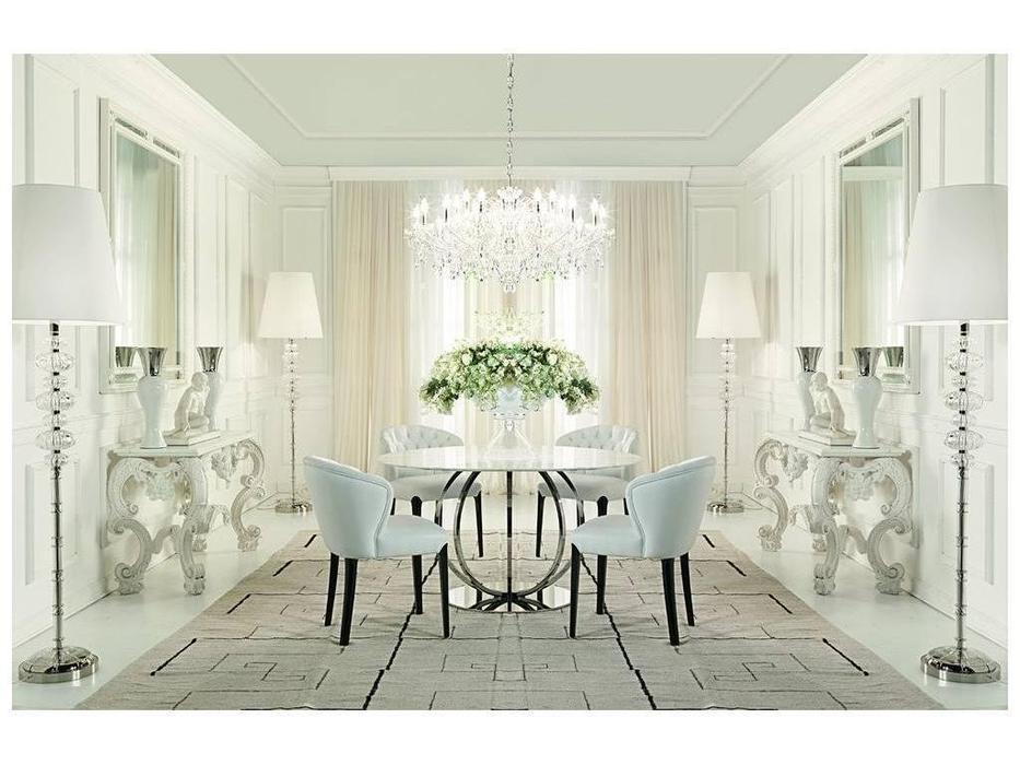 Zanaboni: гостиная комната с круглым столом